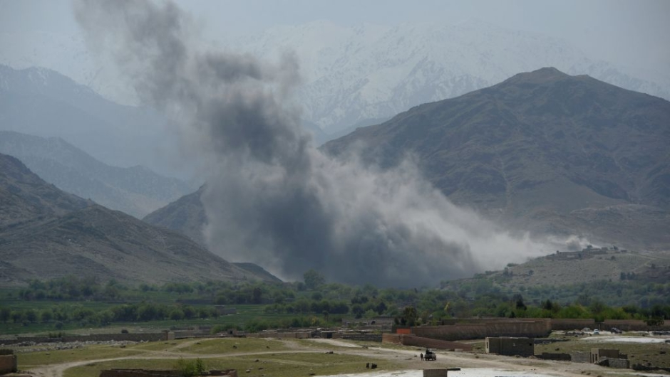 In this photograph taken on April 11, 2017, smoke rises after an air strike by US aircraft on positions during an ongoing an operation against Islamic State (IS) militants in the Achin district of Afghanistan's Nangarhar province. An American special forces soldier has been killed while conducting operations against the Islamic State group in Afghanistan, the US military said.The US-backed Afghan military has vowed to wipe out the group in its strongholds in the eastern province of Nangarhar as IS challenges the more powerful Taliban on its own turf. / AFP PHOTO / NOORULLAH SHIRZADA (Photo credit should read NOORULLAH SHIRZADA/AFP/Getty Images)