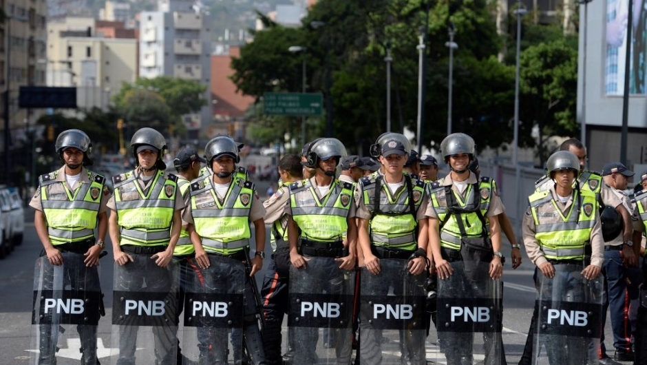 Riot police forces are deployed waiting for demonstrations in Caracas on April 19, 2017. Venezuela braced for rival demonstrations Wednesday for and against President Nicolas Maduro, whose push to tighten his grip on power has triggered waves of deadly unrest that have escalated the country's political and economic crisis. / AFP PHOTO / FEDERICO PARRA (Photo credit should read FEDERICO PARRA/AFP/Getty Images)