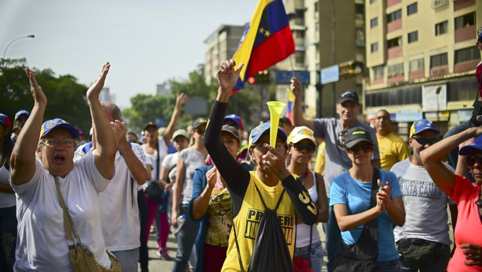 Demonstrators against Nicolas Maduro's government start gathering at the east side of Caracas on April 19, 2017. Venezuela braced for rival demonstrations Wednesday for and against President Nicolas Maduro, whose push to tighten his grip on power has triggered waves of deadly unrest that have escalated the country's political and economic crisis. / AFP PHOTO / RONALDO SCHEMIDT (Photo credit should read RONALDO SCHEMIDT/AFP/Getty Images)