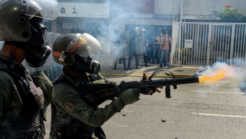 Members of the National Guard crack down on opposition demonstrators during a march against President Nicolas Maduro, in Caracas on April 26, 2017. Venezuelan riot police fired tear gas to stop anti-government protesters from marching on central Caracas, the latest clash in a wave of unrest that, up to now, has left 26 people dead. / AFP PHOTO / FEDERICO PARRA (Photo credit should read FEDERICO PARRA/AFP/Getty Images)