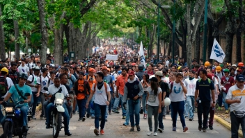 "Venezuela's Central University students march to the education ministry, during a protest against President Nicolas Maduro, in Caracas on May 8, 2017. Venezuela's opposition mobilized Monday in fresh street protests against President Nicolas Maduro's efforts to reform the constitution in a deadly political crisis. Supporters of the opposition Democratic Unity Roundtable (MUD) gathered in eastern Caracas to march to the education ministry under the slogan ""No to the dictatorship."" / AFP PHOTO / FEDERICO PARRA (Photo credit should read FEDERICO PARRA/AFP/Getty Images)"