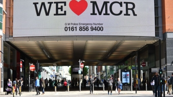 "A sign that reads ""We Love MCR"" is displayed in solidarity above a street in central Manchester, northwest England on May 23, 2017 following a deadly terror attack at a concert at the Manchester Arena the night before. Twenty two people have been killed and dozens injured in Britain's deadliest terror attack in over a decade after a suspected suicide bomber targeted fans leaving a concert of US singer Ariana Grande in Manchester. / AFP PHOTO / Ben STANSALL (Photo credit should read BEN STANSALL/AFP/Getty Images)"
