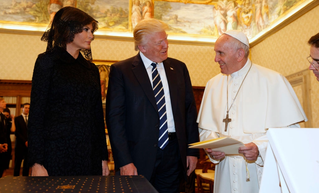 Pope Francis (R) exchanges gifts with US President Donald Trump and US First Lady Melania Trump during a private audience at the Vatican on May 24, 2017. US President Donald Trump met Pope Francis at the Vatican today in a keenly-anticipated first face-to-face encounter between two world leaders who have clashed repeatedly on several issues. / AFP PHOTO / POOL / Evan Vucci (Photo credit should read EVAN VUCCI/AFP/Getty Images)