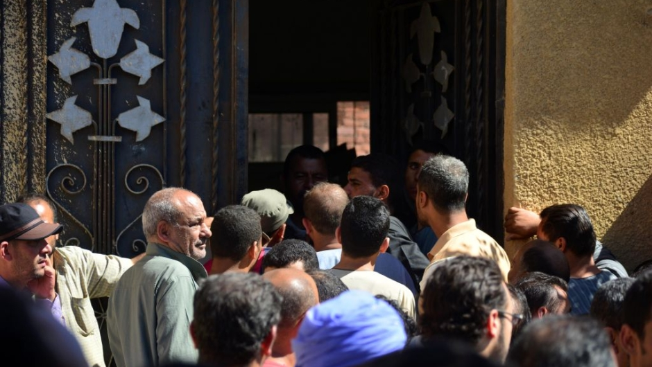 Egyptians wait outside a hospital to retreive some of the bodies of the victims of an attack, in which 28 Coptic pilgirms were gunned down following a visit to a monastery, in Idwah district of the Minya province, some 260 kms south of the capital Cairo, on May 26, 2017. The assailants in three pick-up trucks attacked the bus as it carried visitors to the Saint Samuel monastery in Minya province, more than 200 kilometres (120 miles) from Cairo, before fleeing, the interior ministry said. / AFP PHOTO / STRINGER (Photo credit should read STRINGER/AFP/Getty Images)