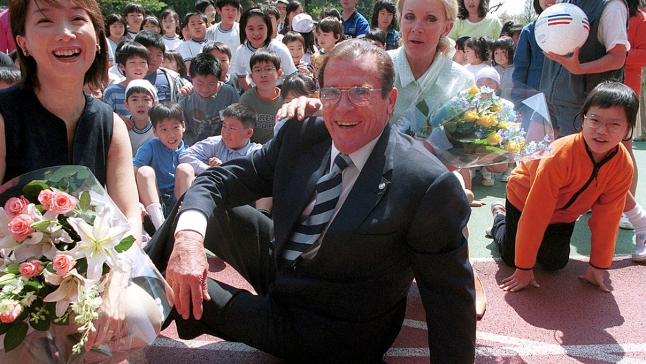387893 01: Actor Roger Moore, who performed as the English spy James Bond in films in the 1970s and 1980s, meets with elementary school children as a UNICEF goodwill ambassador April 16, 2001 in Tokyo, Japan. Moore is visiting Japan to help promote awareness about an international conference, to be held in Yokohama in December, concerning the sexual exploitation of children. (Photo by Koichi Kamoshida/Newsmakers)