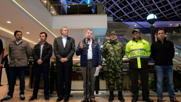Colombian President Juan Manuel Santos speaks inside a shopping center, following an explosion which, according to authorities, left three dead and eleven injured, in Bogota, Colombia, on June 17, 2017. Police said an explosion tore through a women's restroom area of the mall, crowded with shoppers ahead of Father's Day, in an upscale area of the Colombian capital that is popular with foreign nationals. / AFP PHOTO / Raul Arboleda (Photo credit should read RAUL ARBOLEDA/AFP/Getty Images)