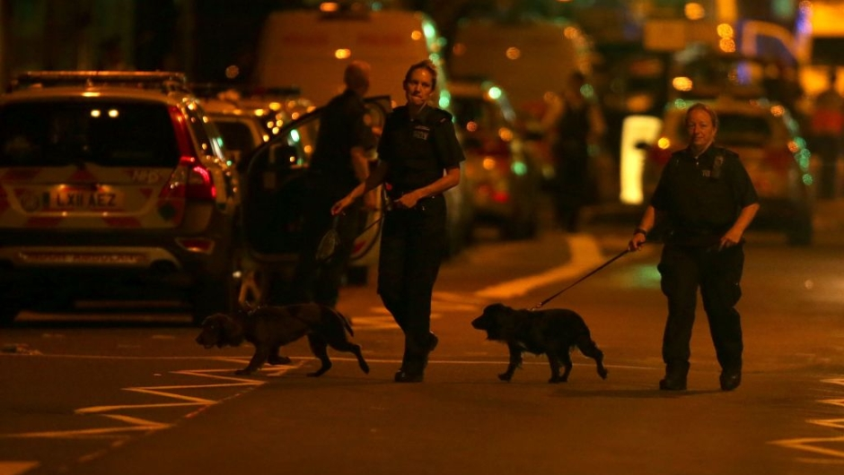 A police K9 unit patrols a street in the Finsbury Park area of north London where a vehichle hit pedestrians on June 19, 2017. One person has been arrested after a vehicle hit pedestrians in north London, injuring several people, police said Monday, as Muslim leaders said worshippers were mown down after leaving a mosque. / AFP PHOTO / Daniel LEAL-OLIVAS (Photo credit should read DANIEL LEAL-OLIVAS/AFP/Getty Images)