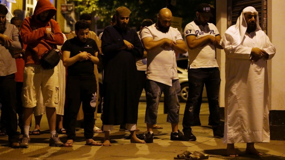 Muslims pray on a sidewalk in the Finsbury Park area of north London after a vehichle hit pedestrians, on June 19, 2017. One person has been arrested after a vehicle hit pedestrians in north London, injuring several people, police said Monday, as Muslim leaders said worshippers were mown down after leaving a mosque. / AFP PHOTO / Daniel LEAL-OLIVAS (Photo credit should read DANIEL LEAL-OLIVAS/AFP/Getty Images)