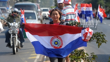 Paraguayan national flag at a street of Asuncion, Paraguay on June 10, 2010. AFP PHOTO/Norberto DUARTE (Photo credit should read NORBERTO DUARTE/AFP/Getty Images)