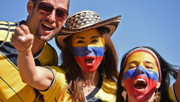 Colombian fans cheer for their team as they arrive to attend the Group C football match between Colombia and Ivory Coast at the Mane Garrincha National Stadium in Brasilia during the 2014 FIFA World Cup on June 19, 2014. AFP PHOTO / PEDRO UGARTE (Photo credit should read PEDRO UGARTE/AFP/Getty Images)