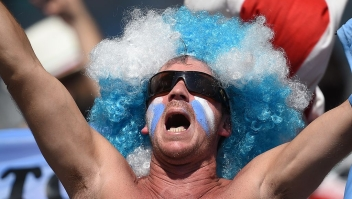 An Argentinian fan with his face painted in the colours of his national flag cheers prior to the Group F football match between Argentina and Iran at the Mineirao Stadium in Belo Horizonte during the 2014 FIFA World Cup in Brazil on June 21, 2014. AFP PHOTO / PEDRO UGARTE (Photo credit should read PEDRO UGARTE/AFP/Getty Images)