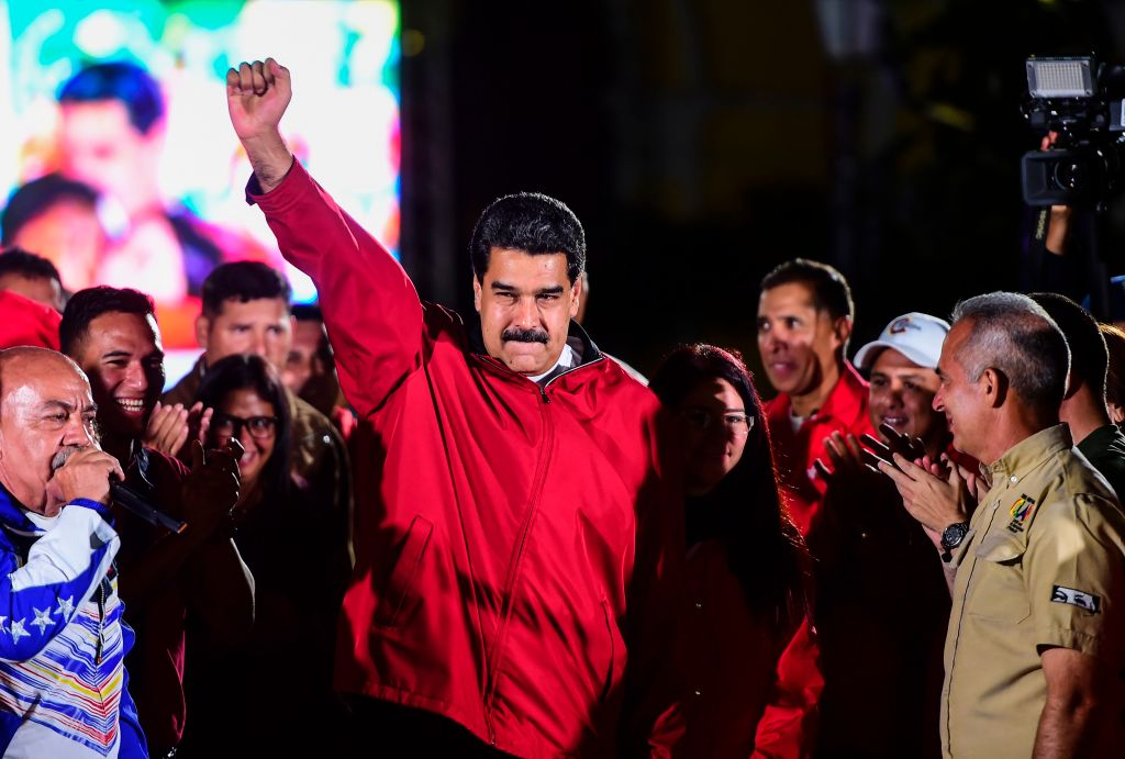"""TOPSHOT - Venezuelan president Nicolas Maduro celebrates the results of """"Constituent Assembly"""", in Caracas, on July 31, 2017. Deadly violence erupted around the controversial vote, with a candidate to the all-powerful body being elected shot dead and troops firing weapons to clear protesters in Caracas and elsewhere. / AFP PHOTO / RONALDO SCHEMIDT (Photo credit should read RONALDO SCHEMIDT/AFP/Getty Images)"""