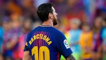 "Barcelona's Argentinian forward Lionel Messi stands with his jersey reading ""Barcelona"" instead of his name to pay tribute to the victims of the Barcelona and Cambrils attacks before the Spanish league footbal match FC Barcelona vs Real Betis at the Camp Nou stadium in Barcelona on August 20, 2017. Drivers have ploughed on August 17, 2017 into pedestrians in two quick-succession, separate attacks in Barcelona and another popular Spanish seaside city, leaving 14 people dead and injuring more than 100 others. / AFP PHOTO / LLUIS GENE (Photo credit should read LLUIS GENE/AFP/Getty Images)"