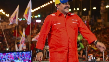 Argentina's football legend Diego Maradona takes part in the closing rally of the electoral campaign of Venezuelan acting President and presidential candidate Nicolas Maduro (out of frame) in Caracas on April 11, 2013 ahead od Sunday's presidential election. Maduro and opposition rival Henrique Capriles held big rallies Thursday, closing a brief and bitter race to succeed Hugo Chavez on the anniversary of a failed coup against the late leader. AFP PHOTO/Luis Acosta (Photo credit should read LUIS ACOSTA/AFP/Getty Images)