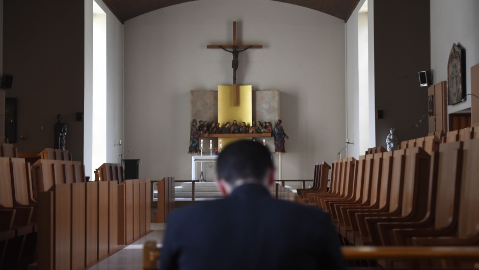A seminarian from the Saint Martin community communes with himself in a chapel at the Abbey of Evron, on June 22, 2017. The Saint Martin Community based in the biggest seminar in France provides priests and secular deacons living their apostolate together in increasingly numerous dioceses. / AFP PHOTO / DAMIEN MEYER (Photo credit should read DAMIEN MEYER/AFP/Getty Images)