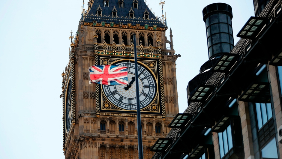 A Union flag flies at half-mast from the roof of a building, in front of a face of the Great Clock of the Palace of Westminster's Elizabeth Tower, more commonly referred to as Big Ben, in London on August 18, 2017, following the August 17 attacks in Barcelona and Cambrils in Spain. Spanish police on Friday hunted for the driver who rammed a van into pedestrians on an avenue crowded with tourists in Barcelona, leaving 13 people dead and more than 100 injured, just hours before a second assault in a resort along the coast. / AFP PHOTO / Tolga AKMEN (Photo credit should read TOLGA AKMEN/AFP/Getty Images)