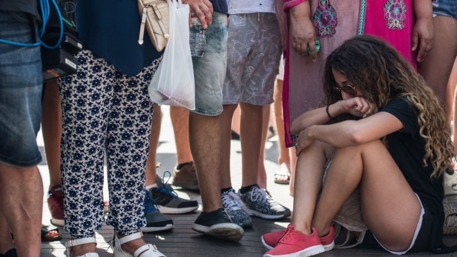 BARCELONA, SPAIN - AUGUST 18: A woman weeps as she sits on Las Ramblas near the scene of yesterday's terrorist attack, on August 18, 2017 in Barcelona, Spain. Fourteen people were killed and dozens injured when a van hit crowds in the Las Ramblas area of Barcelona on Thursday. Spanish police have also killed five suspected terrorists in the town of Cambrils to stop a second terrorist attack. (Photo by Carl Court/Getty Images)