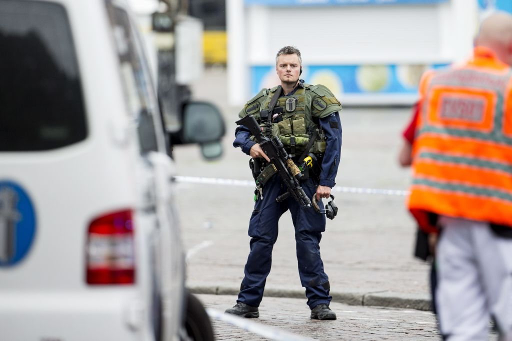 An armed police officer stands guard at the Turku Market Square in the Finnish city of Turku where several people were stabbed on August 18, 2017. One person was killed and eight were injured in a stabbing spree in the Finnish city of Turku, a hospital director said, after police shot one suspect and warned several others could be at large. / AFP PHOTO / Lehtikuva / Roni Lehti / Finland OUT (Photo credit should read RONI LEHTI/AFP/Getty Images)