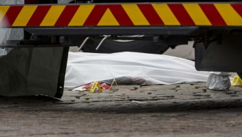 Rescue personnel have covered a stabbing victim's body at the Turku Market Square in the Finnish city of Turku where several people were stabbed on August 18, 2017. One person was killed and eight were injured in a stabbing spree in the Finnish city of Turku, a hospital director said, after police shot one suspect and warned several others could be at large. / AFP PHOTO / Lehtikuva / Roni Lehti / Finland OUT (Photo credit should read RONI LEHTI/AFP/Getty Images)