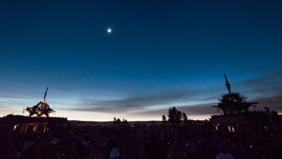 """The sun's corona only is visible during a total solar eclipse between the Solar Temples at Big Summit Prairie ranch in Oregon's Ochoco National Forest near the city of Mitchell August 21, 2017. The Sun started to vanish behind the Moon as the partial phase of the so-called Great American Eclipse began Monday, with millions of eager sky-gazers soon to witness """"totality"""" across the nation for the first time in nearly a century. / AFP PHOTO / Robyn Beck (Photo credit should read ROBYN BECK/AFP/Getty Images)"""