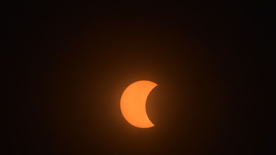 """The total solar eclipse is viewd from Charleston, South Carolina, on August 21, 2017. The Sun started to vanish behind the Moon as the partial phase of the so-called Great American Eclipse began Monday, with millions of eager sky-gazers soon to witness """"totality"""" across the nation for the first time in nearly a century. / AFP PHOTO / MANDEL NGAN (Photo credit should read MANDEL NGAN/AFP/Getty Images)"""