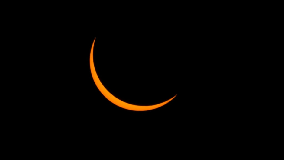 A thin crescent sun is viewed just before totality during a solar eclipse seen from the Lowell Observatory Solar Eclipse Experience on August 21, 2017 in Madras, Oregon. Emotional sky-gazers on the US West Coast cheered and applauded Monday as the Sun briefly vanished behind the Moon -- a rare total solar eclipse that will stretch across North America for the first time in nearly a century. / AFP PHOTO / STAN HONDA (Photo credit should read STAN HONDA/AFP/Getty Images)