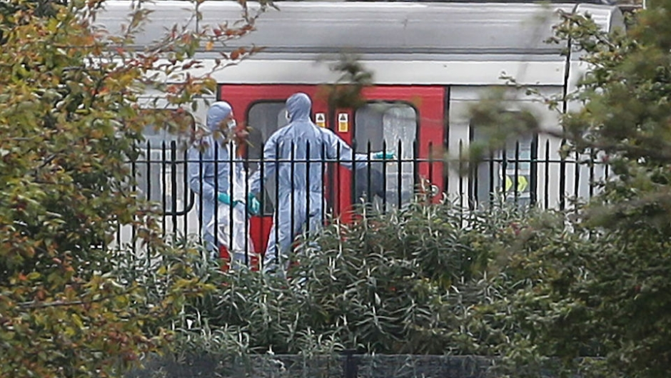"""Police forensics officers works alongside an underground tube train at a platform at Parsons Green underground tube station in west London on September 15, 2017, following an incident on an underground tube carriage at the station. British police are treating an incident on a London Underground train on Friday as an act of terrorism, saying """"a number of people"""" had been injured. """"Terrorist incident declared at Parsons Green Underground Station,"""" police said in a statement. / AFP PHOTO / Daniel LEAL-OLIVAS (Photo credit should read DANIEL LEAL-OLIVAS/AFP/Getty Images)"""