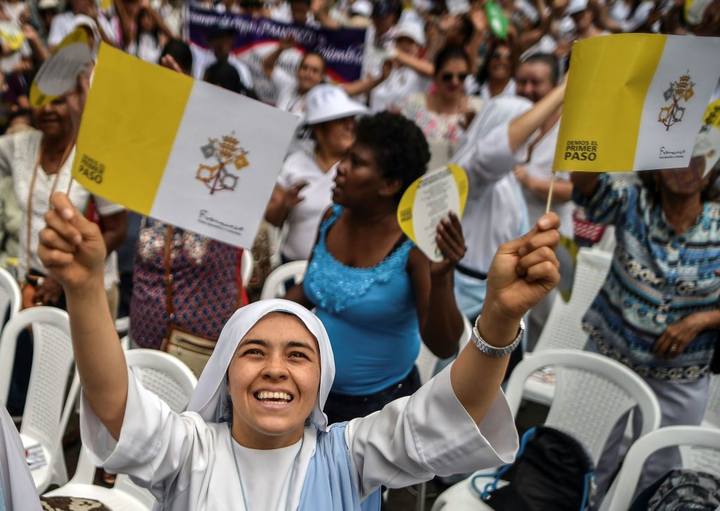 A nun smiles during a Mass ahead of Pope Francis' visit to Colombia, in Cali on September 2, 2017. Pope Francis will make a special four-day visit to Colombia, from September 6 to 11, to add his weight to the process of reconciliation between the government and the FARC. / AFP PHOTO / LUIS ROBAYO (Photo credit should read LUIS ROBAYO/AFP/Getty Images)