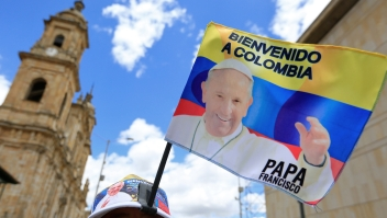 A vendor sells flags with the image of Pope Francis in downtown Bogota on September 4, 2017 ahead of the pontiff's visit to Colombia. Pope Francis will make a special four-day visit to Colombia, from September 6-11, to add his weight to the process of reconciliation between the government and the FARC. / AFP PHOTO / John Vizcaino (Photo credit should read JOHN VIZCAINO/AFP/Getty Images)