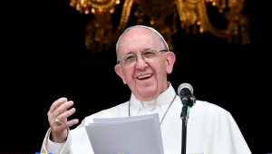 """Pope Francis delivers a speech from a balcony of the Archbishop's Palace to people gathering at Bolivar Square in Bogota on September 7, 2017. Pope Francis urged Colombians to avoid seeking """"vengeance"""" for the sufferings of their country's half-century civil conflict as they work towards a lasting peace. The 80-year-old pontiff spoke alongside Colombia's President Juan Manuel Santos, who has overseen recent controversial efforts to make peace with armed rebel groups. / AFP PHOTO / Alberto PIZZOLI (Photo credit should read ALBERTO PIZZOLI/AFP/Getty Images)"""