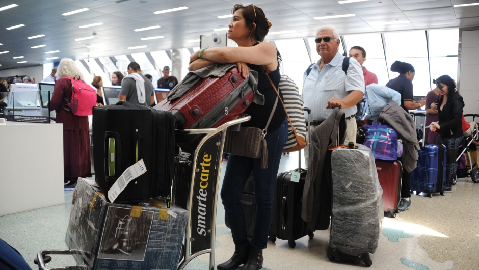 People crowd Fort Lauderdale International Airport as evacuation is underway for the arrival of Hurricane Irma, September 7, 2017 in Fort Lauderdale, Florida. Hurricane Irma, one of the most powerful Atlantic storms on record, cut a deadly swath through a string of small Caribbean islands and was on a collision course with Puerto Rico and potentially south Florida. / AFP PHOTO / Michele Eve Sandberg (Photo credit should read MICHELE EVE SANDBERG/AFP/Getty Images)