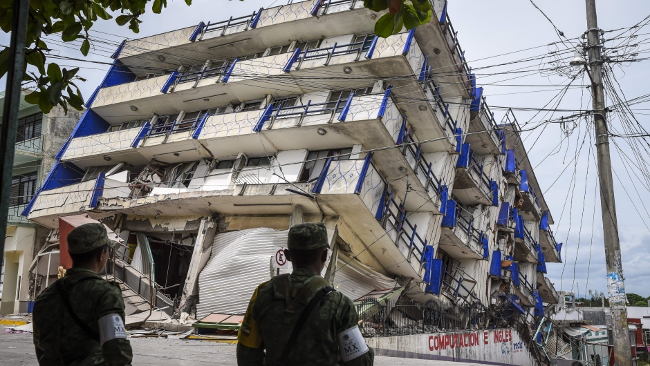 Soldiers stand guard a few metres away from the Sensacion hotel which collapsed with the powerful earthquake that struck Mexico overnight, in Matias Romero, Oaxaca State, on September 8, 2017. Mexico's most powerful earthquake in a century killed at least 35 people, officials said Friday, after it struck the Pacific coast, wrecking homes and sending families fleeing into the streets. / AFP PHOTO / VICTORIA RAZO (Photo credit should read VICTORIA RAZO/AFP/Getty Images)