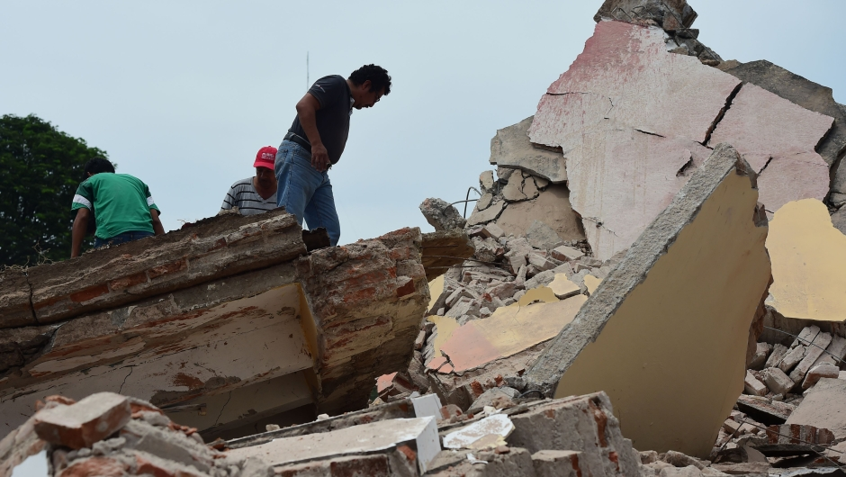 Local police members and volunteers remove rubble after the Town Hall building partially collapsed following an 8.2 earthquake that hit Mexico's Pacific coast, in Juchitan de Zaragoza, state of Oaxaca on September 8, 2017. Mexico's most powerful earthquake in a century killed at least 35 people, officials said, after it struck the Pacific coast, wrecking homes and sending families fleeing into the streets. / AFP PHOTO / RONALDO SCHEMIDT (Photo credit should read RONALDO SCHEMIDT/AFP/Getty Images)