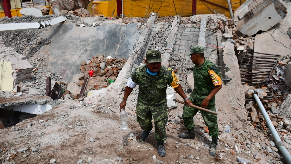 Mexican soldiers walk amid debris of the Town Hall building which partially collapsed following an 8.2 magnitude earthquake that hit Mexico's Pacific coast, in Juchitan de Zaragoza, state of Oaxaca on September 8, 2017. Mexico's most powerful earthquake in a century killed at least 35 people, officials said, after it struck the Pacific coast, wrecking homes and sending families fleeing into the streets. / AFP PHOTO / RONALDO SCHEMIDT (Photo credit should read RONALDO SCHEMIDT/AFP/Getty Images)