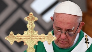 """Pope Francis celebrates an open-air mass at Contecar -Cartagena's maritime terminal- during the last day of his visit to Colombia on September 10, 2017. Pope Francis prayed Sunday for a peaceful end to Venezuela's """"grave crisis"""" which has left scores dead, as he wrapped up a tour to support peace in neighboring Colombia. / AFP PHOTO / Alberto PIZZOLI (Photo credit should read ALBERTO PIZZOLI/AFP/Getty Images)"""