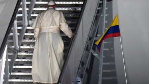 """Pope Francis walks up the stairs while embarking at the Rafael Nunez airport in Cartagena on September 10, 2017. Pope Francis prayed Sunday for a peaceful end to Venezuela's """"grave crisis"""" which has left scores dead, as he wrapped up a tour to support peace in neighboring Colombia. / AFP PHOTO / Luis Acosta (Photo credit should read LUIS ACOSTA/AFP/Getty Images)"""