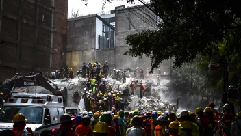 Rescue workers take part in the search for survivors and bodies in Mexico City on September 21, 2017, two days after a strong quake hit central Mexico. A powerful 7.1 earthquake shook Mexico City on Tuesday, causing panic among the megalopolis' 20 million inhabitants on the 32nd anniversary of a devastating 1985 quake. / AFP PHOTO / RONALDO SCHEMIDT (Photo credit should read RONALDO SCHEMIDT/AFP/Getty Images)