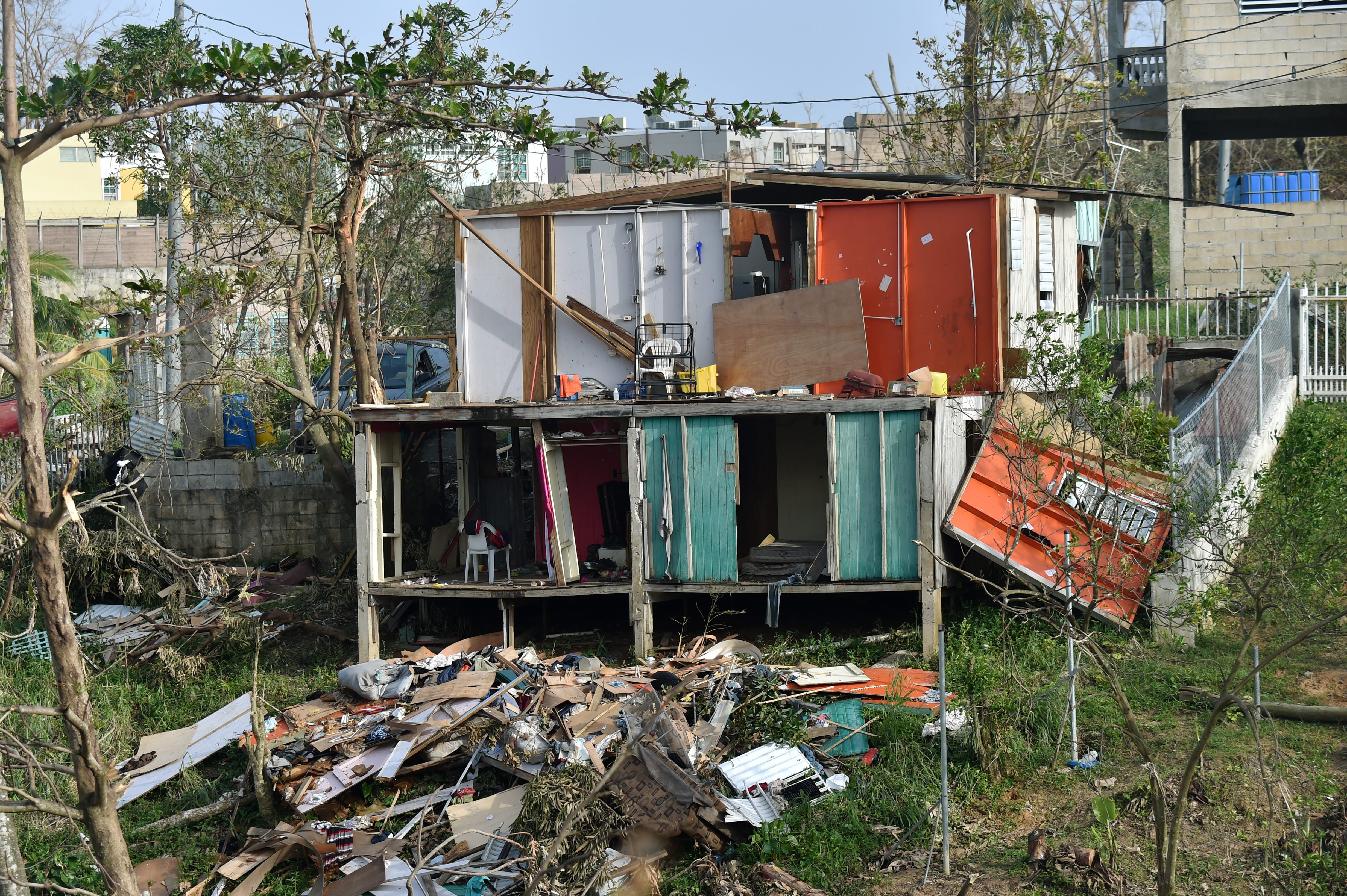 Destroyed homes are seen following passage of Hurricane Maria in the neigborhood of Acerolas in Toa Alto, Puerto Rico, on September 26, 2017. The US island territory, working without electricity, is struggling to dig out and clean up from its disastrous brush with the hurricane, blamed for at least 33 deaths across the Caribbean. / AFP PHOTO / HECTOR RETAMAL (Photo credit should read HECTOR RETAMAL/AFP/Getty Images)