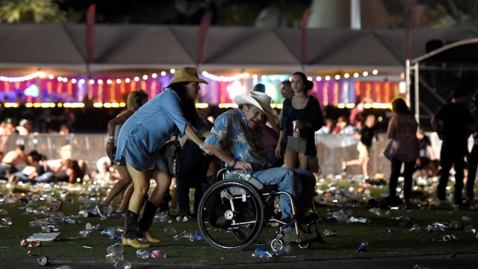 LAS VEGAS, NV - OCTOBER 01: A man in a wheelchair is taken away from the Route 91 Harvest country music festival after apparent gun fire was heard on October 1, 2017 in Las Vegas, Nevada. There are reports of an active shooter around the Mandalay Bay Resort and Casino. (Photo by David Becker/Getty Images)