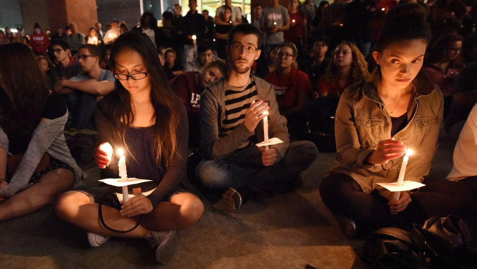 People attend a candlelight vigil at the University of Las Vegas student union October 2, 2017, after a gunman killed at least 58 people and wounded more than 500 others when he opened fire on a country music concert in Las Vegas, Nevada late October 1, 2017. / AFP PHOTO / Robyn Beck (Photo credit should read ROBYN BECK/AFP/Getty Images)