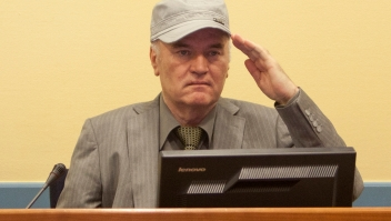 THE HAGUE, NETHERLANDS - JUNE 3: (NETHERLANDS OUT) (EDITORS NOTE: ALTERNATE CROP) Ratko Mladic makes his first appearance at the International Criminal Tribunal on June 3, 2011 in The Hague, Netherlands. Ex-Bosnian Serb army leader Ratko Mladic will make his first appearance at The Hague war crimes tribunal after being declared fit to stand trial. Mladic was arrested a week ago after going into hiding for the past 16 years and is charged with atrocities committed during the Bosnian war. (Photo Serge Ligtenberg/Getty Images )