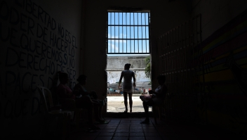 Colombian inmate Arleth Martinez - in prison for extortion - goes out to the courtyard of the San Diego jail in Cartagena, Colombia on August 24, 2017. The Interno is the first restaurant in the country to operate inside a women's prison, sponsored by the Internal Theater foundation. Inmates receive training in this initiative that gives them a second chance at life and reintegration in society. / AFP PHOTO / Raul Arboleda (Photo credit should read RAUL ARBOLEDA/AFP/Getty Images)