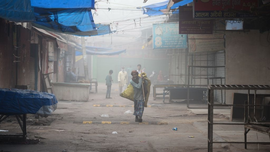 An Indian ragpicker walks amid heavy smog in New Delhi on November 8, 2017. Delhi shut all primary schools on November 8 as pollution levels hit nearly 30 times the World Health Organization safe level, prompting doctors in the Indian capital to warn of a public health emergency. Dense grey smog shrouded the roads of the world's most polluted capital, where many pedestrians and bikers wore masks or covered their mouths with handkerchiefs and scarves. / AFP PHOTO / SAJJAD HUSSAIN (Photo credit should read SAJJAD HUSSAIN/AFP/Getty Images)