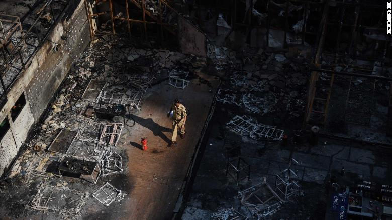 171229)-- MUMBAI,Dec. 29, 2017 (Xinhua) --Police personnel inspect the burned building where a rooftop party was being held in Mumbai early on December 29, 2017.Fire tore through a Mumbai building where a rooftop party was being held early on December 29, killing at least 15 people and leaving many injured, police said.(Xinhua/ Stringer) (Photo by Xinhua/Sipa USA)