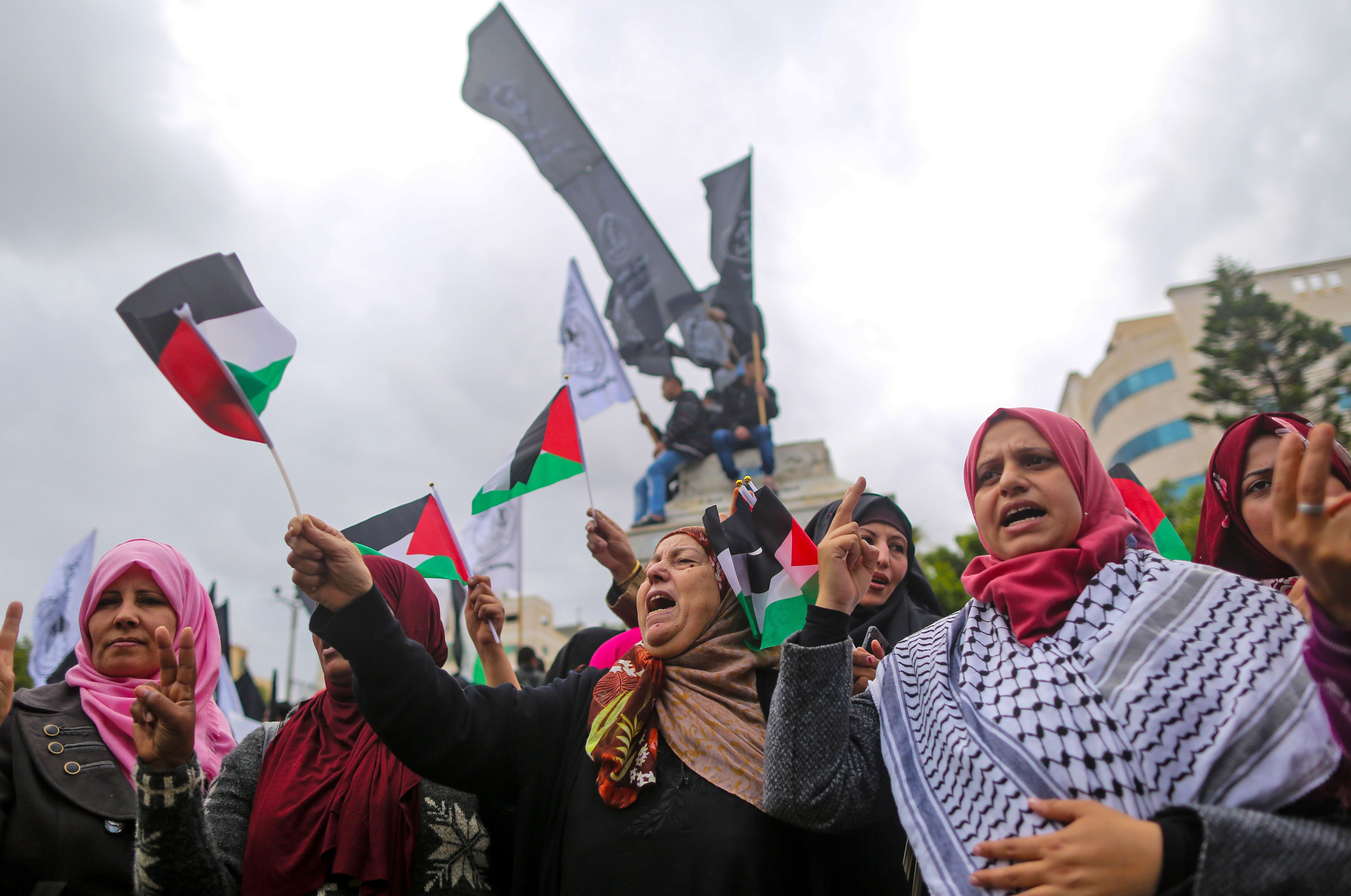 Palestinian women shout slogans during a protest in Gaza City on December 6, 2017. President Donald Trump is set to recognise Jerusalem as Israel's capital, upending decades of careful US policy and ignoring dire warnings from Arab and Western allies alike of a historic misstep that could trigger a surge of violence in the Middle East. / AFP PHOTO / MAHMUD HAMS (Photo credit should read MAHMUD HAMS/AFP/Getty Images)