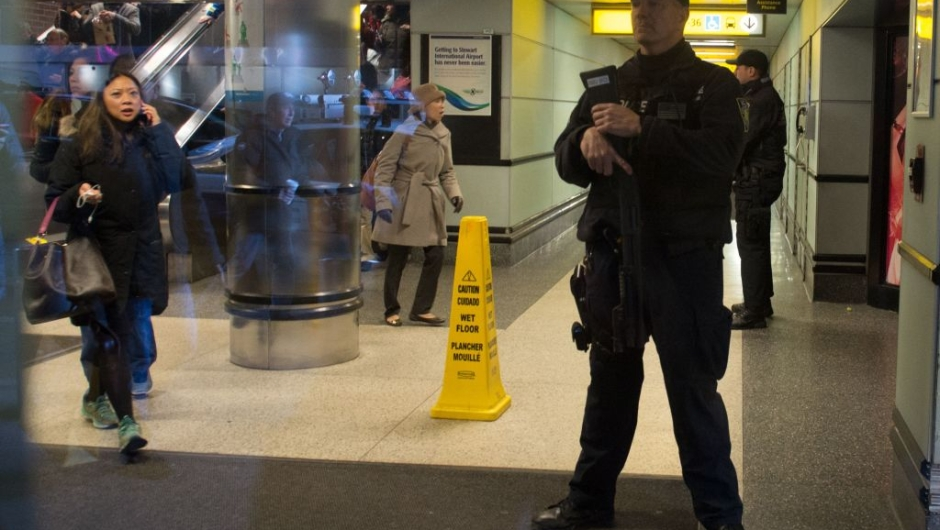 """Port Authority Police watch as people evacuate after a reported explosion at the Port Authority Bus Terminal on December 11, 2017 in New York. New York police said Monday that they were investigating an explosion of """"unknown origin"""" in busy downtown Manhattan, and that people were being evacuated. Media reports said at least one person had been detained after the blast near the Port Authority transit terminal, close to Times Square.Early media reports said the blast came from a pipe bomb, and that several people were injured. / AFP PHOTO / Bryan R. Smith (Photo credit should read BRYAN R. SMITH/AFP/Getty Images)"""