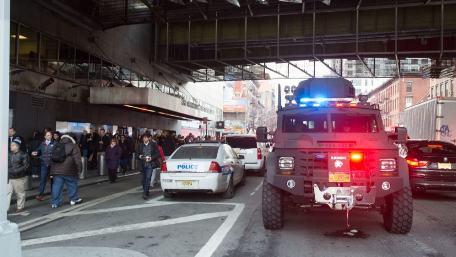 """Police and other first responders respond to a reported explosion at the Port Authority Bus Terminal on December 11, 2017 in New York. New York police said Monday that they were investigating an explosion of """"unknown origin"""" in busy downtown Manhattan, and that people were being evacuated. Media reports said at least one person had been detained after the blast near the Port Authority transit terminal, close to Times Square.Early media reports said the blast came from a pipe bomb, and that several people were injured. / AFP PHOTO / Bryan R. Smith (Photo credit should read BRYAN R. SMITH/AFP/Getty Images)"""