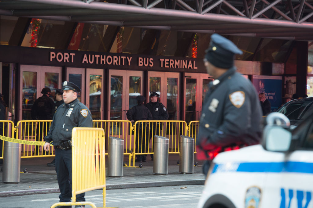 """Police respond to a reported explosion at the Port Authority Bus Terminal on December 11, 2017 in New York. New York police said Monday that they were investigating an explosion of """"unknown origin"""" in busy downtown Manhattan, and that people were being evacuated. Media reports said at least one person had been detained after the blast near the Port Authority transit terminal, close to Times Square.Early media reports said the blast came from a pipe bomb, and that several people were injured. / AFP PHOTO / Bryan R. Smith (Photo credit should read BRYAN R. SMITH/AFP/Getty Images)"""