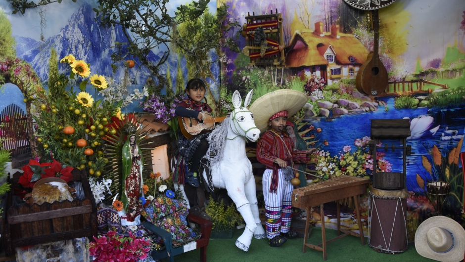 Children play guitar and marimba during the celebration of the apparition of the Virgin of Guadalupe to indigenous peasant Juan Diego in Mexico in 1531, at the basilica of the Virgin of Guadalupe, in downtown Guatemala City, on December 12, 2017. / AFP PHOTO / Johan ORDONEZ (Photo credit should read JOHAN ORDONEZ/AFP/Getty Images)