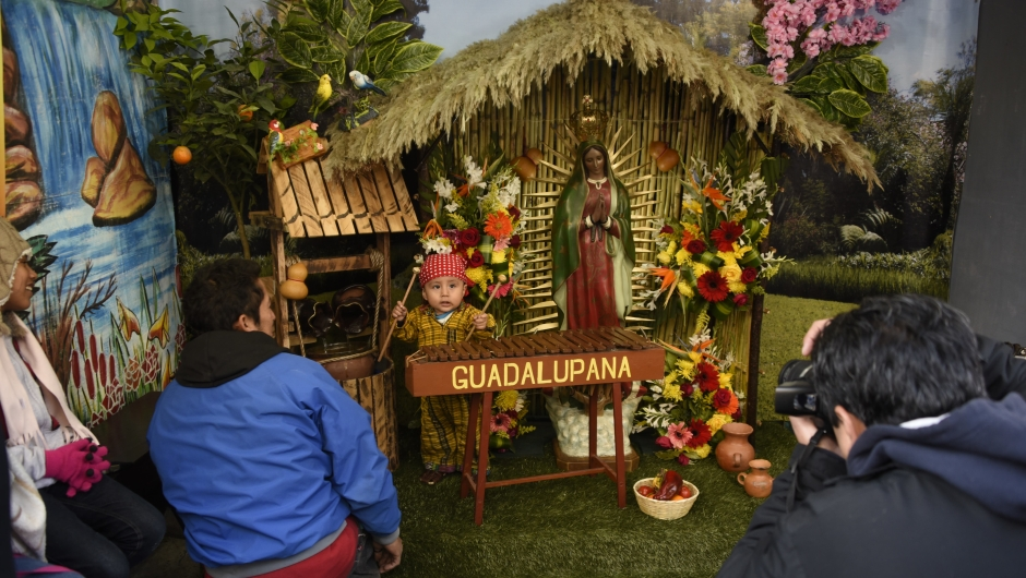 A child dressed as indigenous peasant Juan Diego plays marimba during the celebration of the apparition of the Virgin of Guadalupe to Juan Diego in Mexico in 1531, at the basilica of the Virgin of Guadalupe, in downtown Guatemala City, on December 12, 2017. / AFP PHOTO / Johan ORDONEZ (Photo credit should read JOHAN ORDONEZ/AFP/Getty Images)